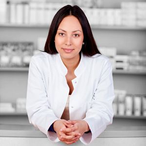 smiling female pharmacist leaning on counter